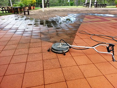 pressure cleaning example of concrete pavers of a pub in Bundaberg