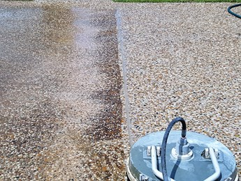 Pressure cleaning of a concrete driveway - one of our concrete cleaning services