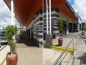 Pressure cleaning of a commercial building and pavement cleaning